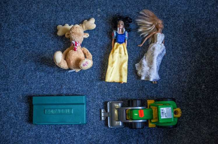 Refugees in Berlin are given toys by volunteers