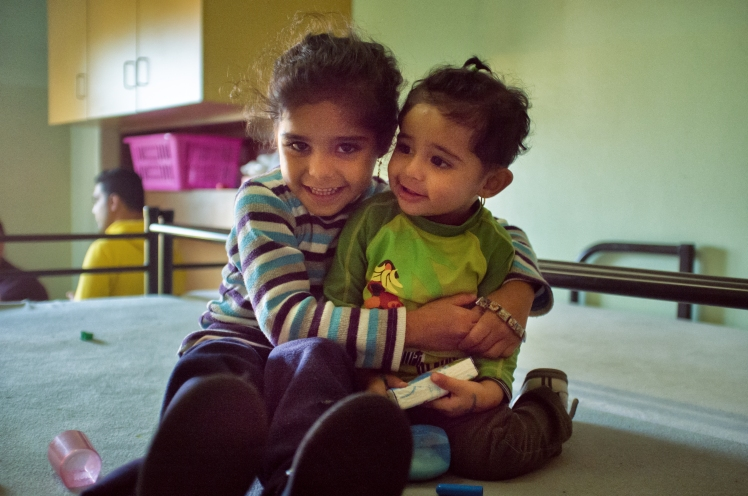 Two girls from Iraq, refugees, in Berlin, Germany