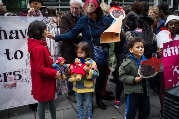 Children dress as Paddington to call on UK Home Office to welcome more child refugees to UK